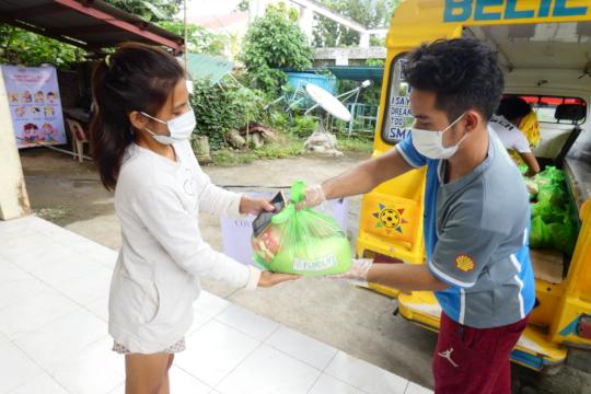 Handing out food packs in Leyte Region