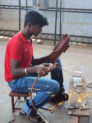 Ravichandran practicing welding during his course