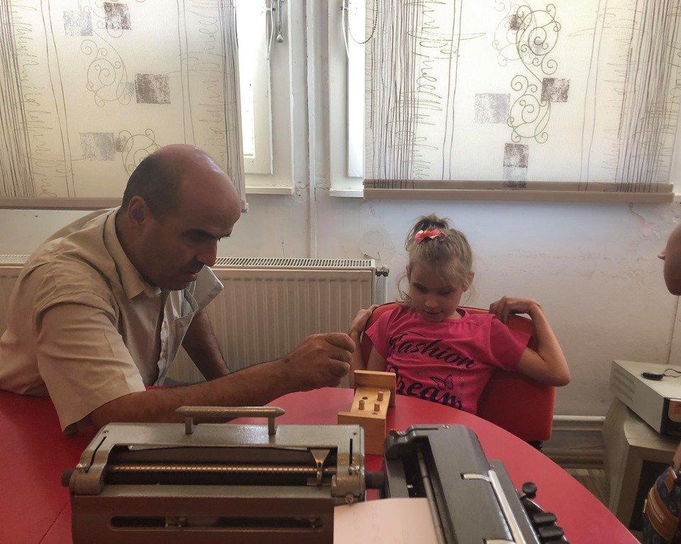 Student Diellza with her teacher