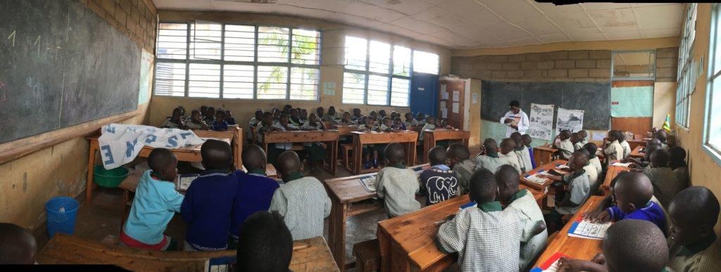 Teacher Josephine with her Primary 1 pupils