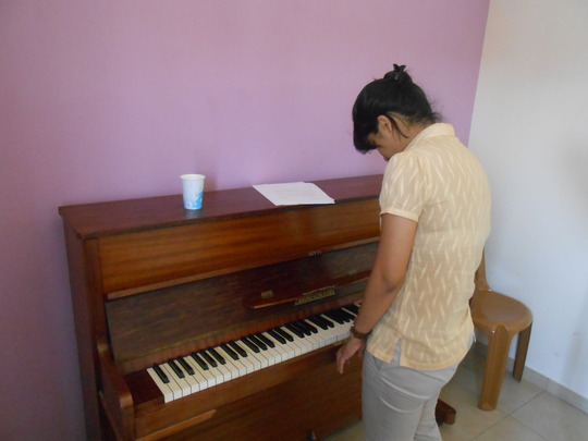 Manmeet getting some piano lessons