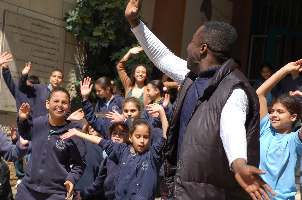 This is at one of the AACT project schools at music workshop with our partners from the Guildhall School for Music and Drama in March 2012. Today kids still do the moves and sing the songs! They made the music, they made the texts, and they performed - with the trainers  opening the creative doors.