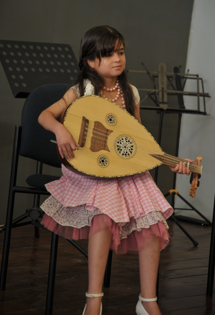 This little lady is one of our Oud students in the AACT project. Here she is on stage at the final concert in June 2012, as one of the excellent students of this year. It was truly amazing to see the changes in the children and what they achieved after a mere 7 months of teaching.