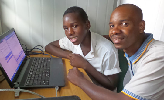 Net Fundi Alfred Teaching a New Net Buddy Mentee