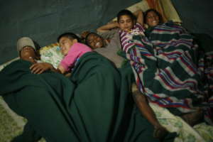 Kids sleeping in the shelter