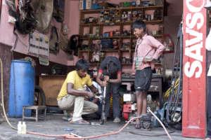 Children being trained in metal work