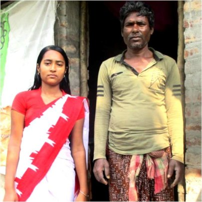 Madhumita* with her father before their house