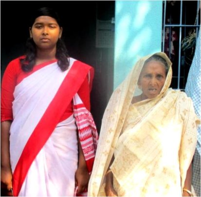Srabana* with her grandmother before their house