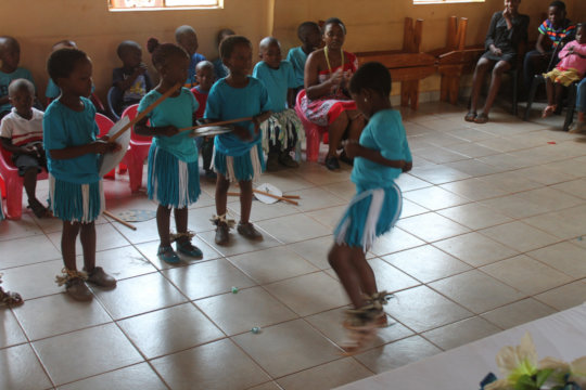 children showing off traditional dance skills