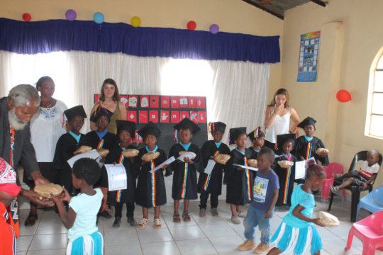 Children receiving gifts from community elder