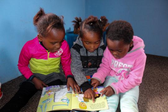 Children enjoying the reading center