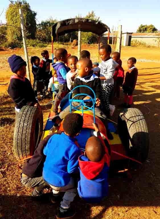 Children scrambling for the motionless car
