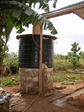 Repaired water tank in place and connected