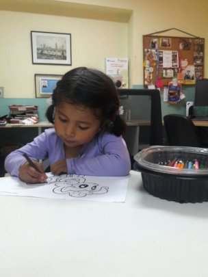 Lucianita painting her favourite cartoon
