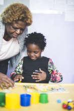 Teaching a child one of the Ndinogona activities