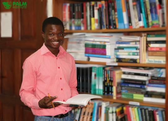 Mahamadu volunteering as a Librarian