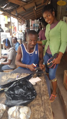 Mercy and her uncle in his shop.