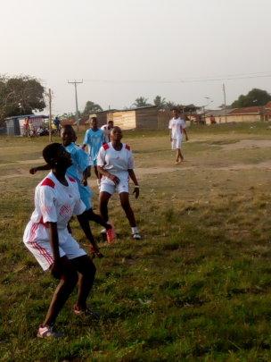 Bedaabour teen girls playing soccer.
