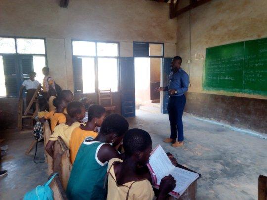 Headmaster Ernest working with the Teen Girls Club