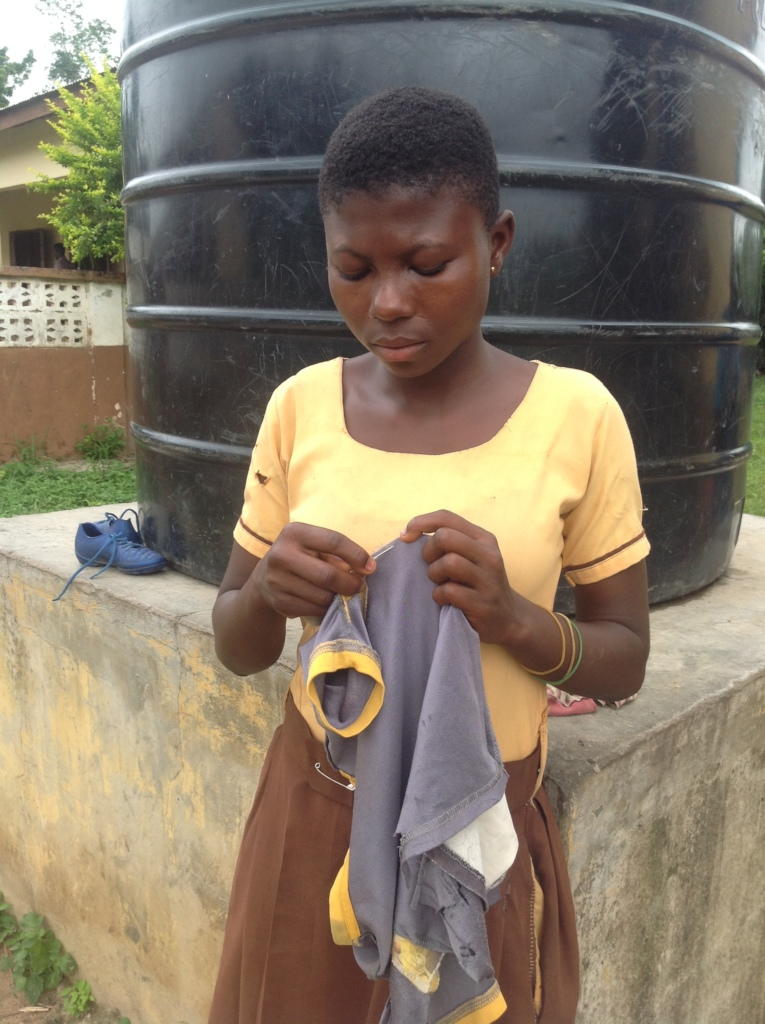 Sherifa mending clothes