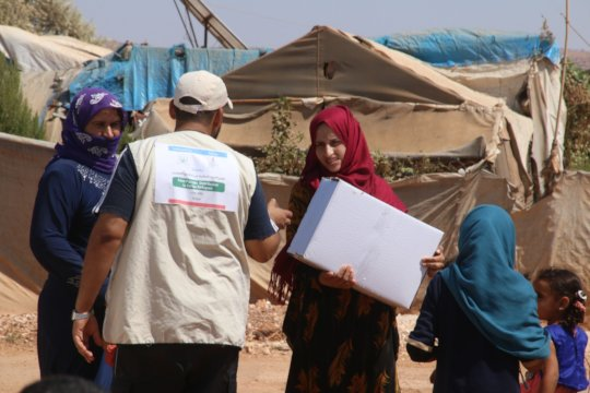 The girls in Refugees camp receiving relief goods