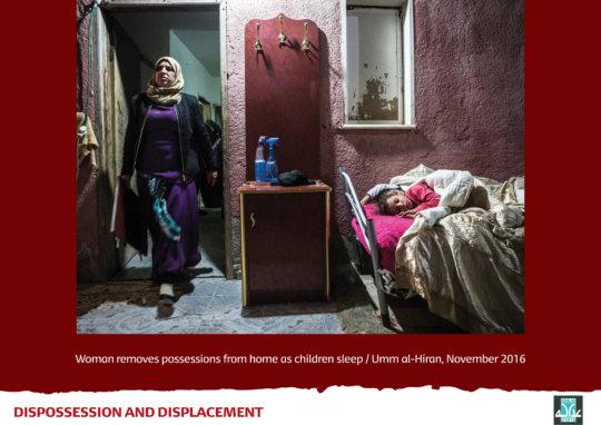 Child sleeps as mother prepares for demolition