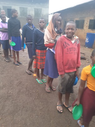 Lining up for lunch is always a joy for children