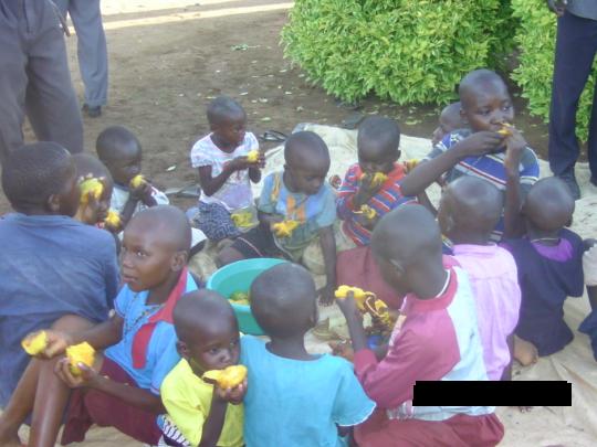 Children enjoying a fruits