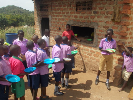 Children line for food at Ramah Orphan's Center