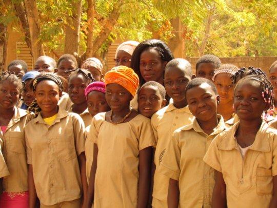 Martine with members of the Girls Awakening Club