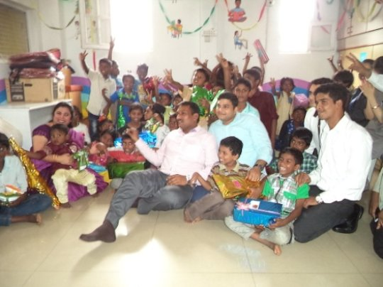 Volunteers giving gifts during Diwali