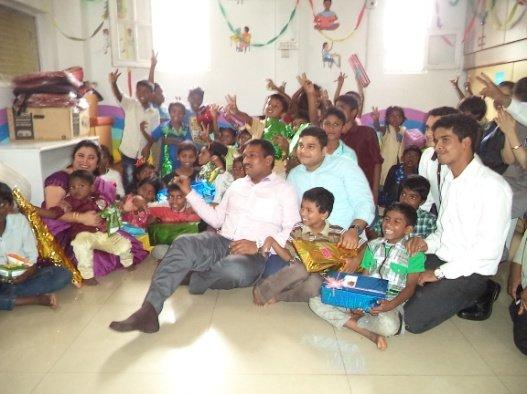 Volunteers giving gifts during Diwali