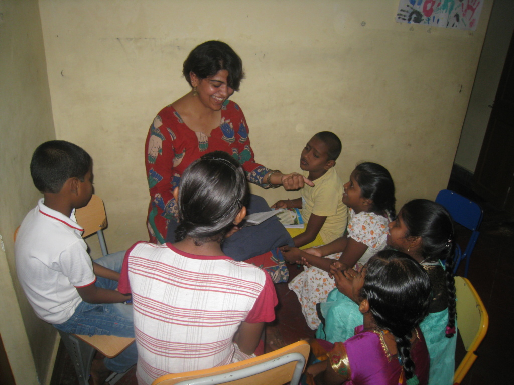 A volunteer teaching the children