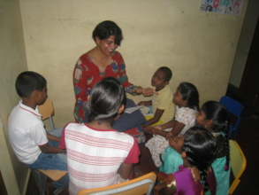 A volunteer teaching the children