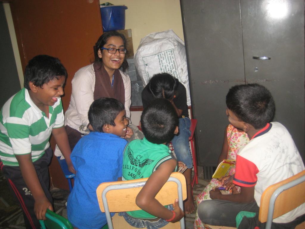 Volunteer teaching the children