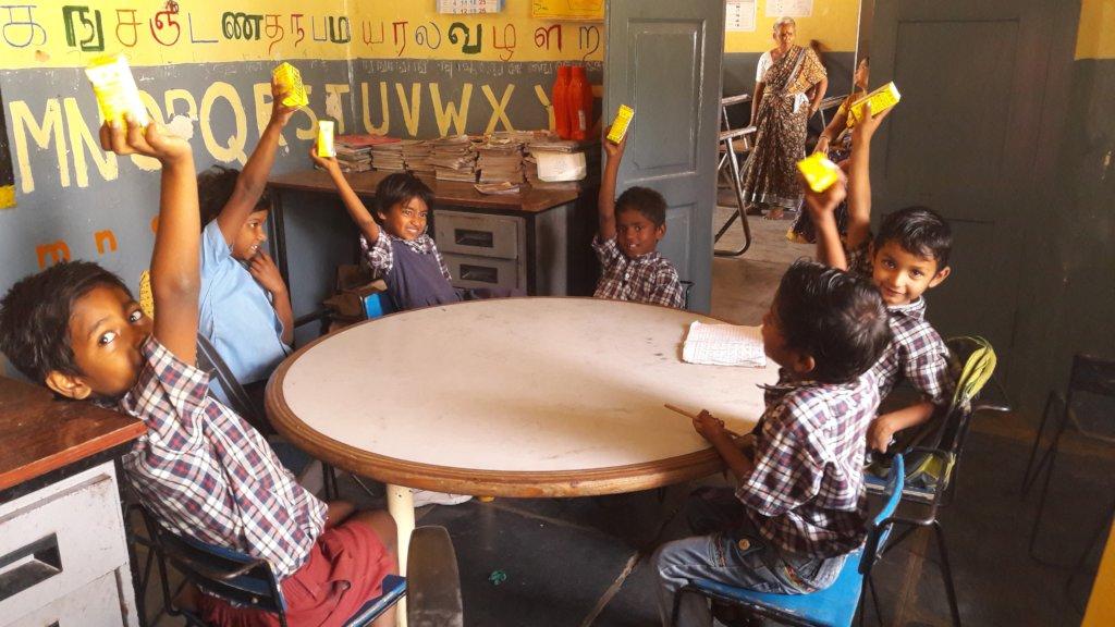 Children enjoying their Saturday snacks.