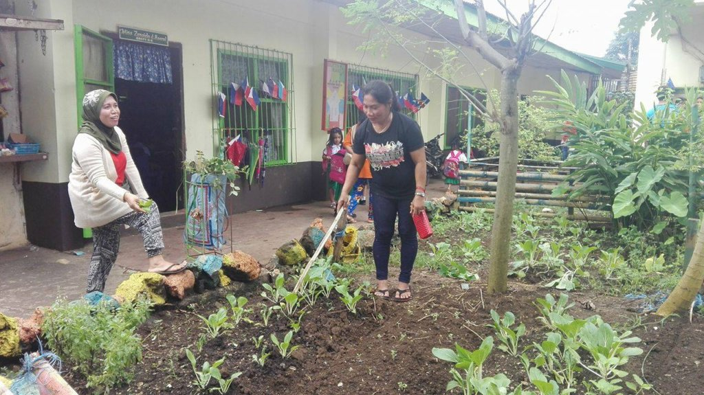water tank supports city school garden in Jolo