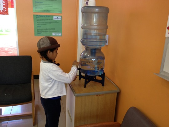 A patient gets clean water @ Clinica Verde