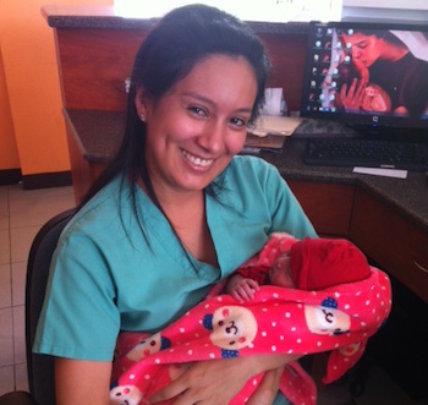Nurse Celina with Maribel's healthy newborn