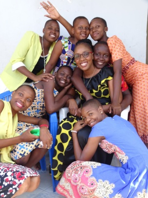 Consoler surrounded by the girls of NHGO
