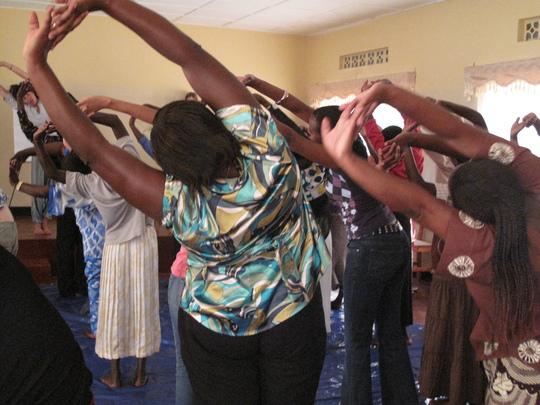 Rwandan women doing yoga