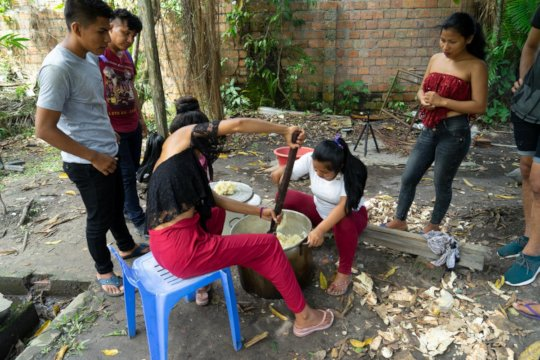 Students preparing the 'masato' traditional drink