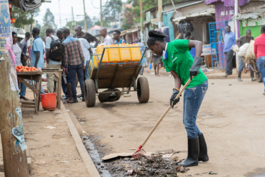 Clean up team doing their work in Kibera slum.