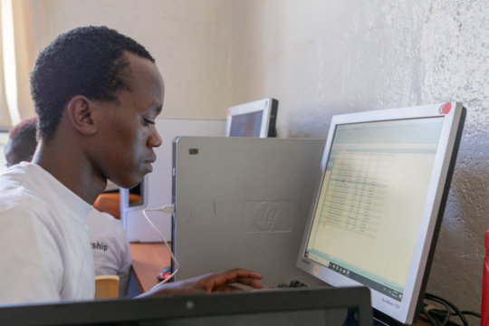 Youth are trained on computer skills.