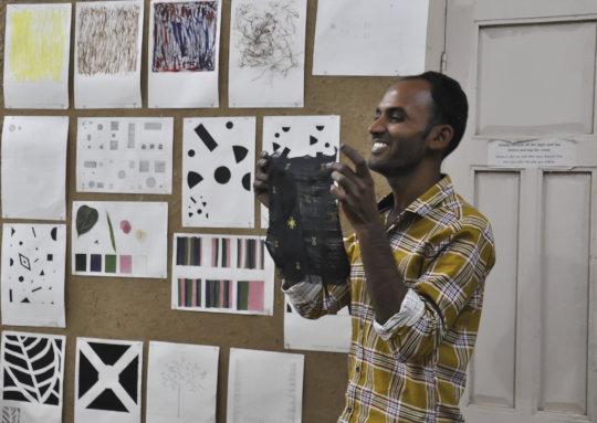 Nanjibhai, a weaver, presents basic design work