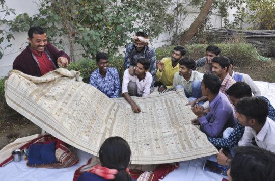 Advisor Shyamjibhai tells students about tradition