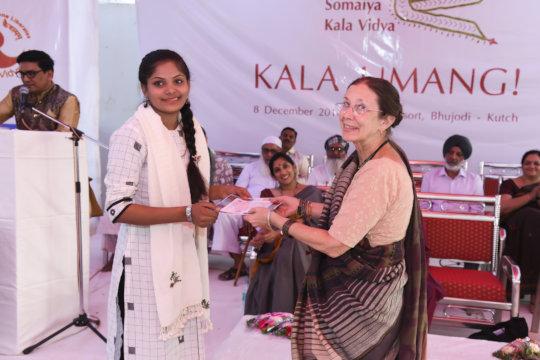 Krishna receives the award for Best Presentation