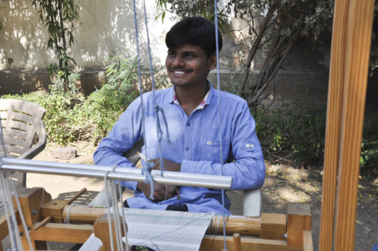 Kalpeshbhai during his practicals on the loom