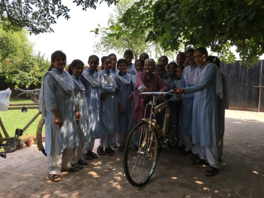 Asma inaugrating the bicycle project