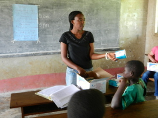 Nurse Lucy handing out sanitary pads